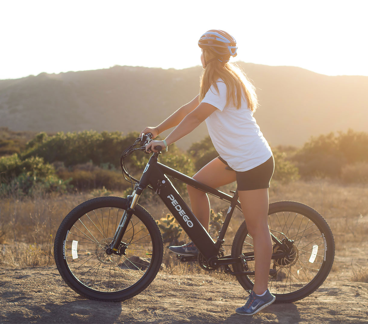 Girl riding Pedego electric bike on trail